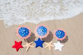 picture of patriot  - Patriotic USA background with starfishes and decorations on the sandy beach - JPG