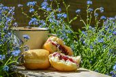 stock photo of forget me not  - coffe and the donuts on wood with forget - JPG