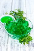 image of jello  - Homemade Woodruff Jello (on a bright wooden background) ** Note: Shallow depth of field - JPG