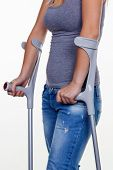 picture of crutch  - a young woman with crutches - JPG