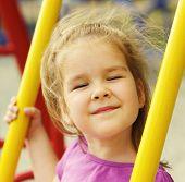 stock photo of playground  - Portrait a little girl on playground - JPG