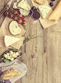 foto of french culture  - French snacks on a wooden table with space for text - JPG