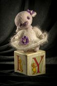 picture of hare  - Doll hare in a lilac dress on the cube - JPG
