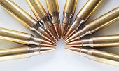 stock photo of piercings  - Rifle cartridges with a steel core considered armor piercing on a white background - JPG