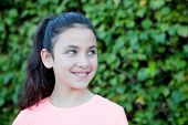 stock photo of  preteen girls  - Happy preteen girl with blue eyes smiling at outside - JPG