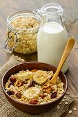 stock photo of whole-grain  - Healthy breakfast - whole grain muesli with a banana and ice cream. ** Note: Shallow depth of field - JPG