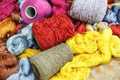 stock photo of silk worm  - Patterned silks of various colors for weaving - JPG