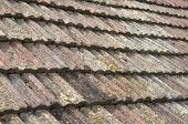stock photo of ceramic tile  - Old roof with ceramic tiles closeup in sunny day
