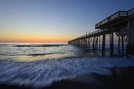 pic of outer  - Motion of waves crashing on the beach at Rodanthe Pier on the Outer Banks of North Carolina - JPG