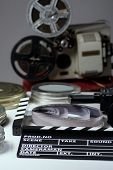 Постер, плакат: Old Retro Camera Film Clapper Rolls Of Film And A 35Mm Boxes For Films And Film Projector