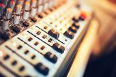 Постер, плакат: Close up Of Music Mixer Button Setting Volume Music Production Mixer Adjustment Tools