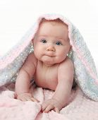 Beautiful baby under a blanket