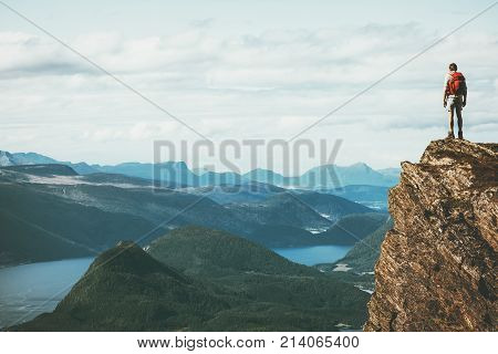 poster of Life on the edge Traveler on cliff mountains over fjord enjoying Norway landscape Travel Lifestyle success motivation concept adventure active vacations outdoor