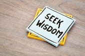 seek wisdom advice or reminder handwriting on a sticky note against grained wood poster