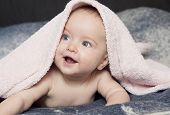Smiling Baby With A Towel