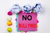 Writing Text Showing No Bullying Written On Sticky Note In Office With Screw Paper Balls. Business C poster