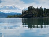 Yukon wilderness reflected on calm lake