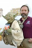 BURBANK, CA - JUNE 23: Obi Shawn and his puppet Yoda arrive at the 37th annual Saturn awards on June