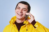 Young Happy Handsome Man Has Phone Conversation, Talks With Best Friend, Discuss Something With Glad poster