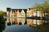 Buildings over looking a river in Brugge Belgium