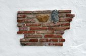 White Wall With Exposed Brick Work