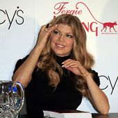 COSTA MESA - DEC 8: Stacy Ferguson aka Fergie launches her handbag collection for Kipling and signs autographs for her fans at Macy's on December 8, 2007  in Costa Mesa, California.