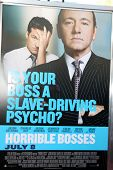 LOS ANGELES - JUN 30:  Horrible Bosses Movie Poster with Jason Bateman & Kevin Spacey arriving at th