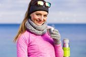 Fit Woman In Cold Day Warming Up Drink Tea poster