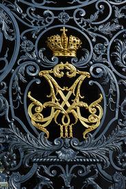 stock photo of zar  - Zar family symbol on winter palace gates in Russia - JPG