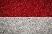 National Flag Of Indonesia On A Stone Background.the Concept Of National Pride And Symbol Of The Cou poster