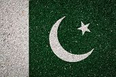 National Flag Of Pakistan On A Stone Background.the Concept Of National Pride And Symbol Of The Coun poster