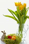 Painted Ester egg with Easter bunny and yellow flowers
