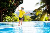 Child In Swimming Pool. Summer Vacation With Kids. poster