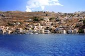 Greece. Dodecanesse. Island Symi (Simi). Colorful houses on rocks.