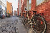 Two Locked Bicycycles In Copenhagen Colorful Old Town Street poster