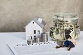 House Model On White Table With Silver Coins, Keys, Contract And Moneybox On Grey Background, Real E poster