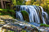 The small Croatian town of Slunj. Magnificent cascade of waterfalls on the Koran River. Magnificent  poster