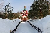 stock photo of eminent  - beautiful winter landscape with church on eminences - JPG
