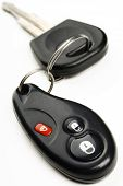 stock photo of car key  - a car key with the remote control pendant attached to it on white - JPG