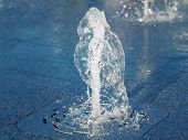 Vertical Water Stream Flowing Out Of Stainless Grate Of Dry Fountain, Close Up View. Water Stream Sp poster