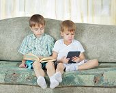 Two Reading Boys. With Paper And Electronic Book