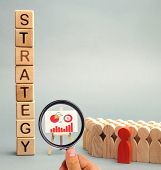 Wooden Blocks With The Word Strategy, Business Schedule And Team Of Employees. Business Strategy Is  poster