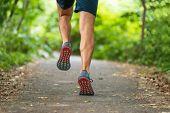 Runner man training marathon run race running on forest park city path outdoors from behind sprintin poster