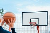 Attractive Man Playing Basketball And Dunking Basketball In Hoop On Basketball Court. poster