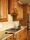 Luxury Model Home Honey Kitchen Cabinets