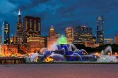 Chicago Skyline Panorama At Night With Skyscrapers And Buckingham Fountain, Chicago, Illinois, Usa. poster