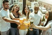 Young Group Of Friends Drinking Beer, Having Fun, Laughting And Celebrating Together. Women And Men  poster