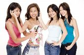picture of foursome  - four beautiful young asian women using cellphones - JPG