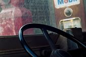 Interior Of Classic Vintage Car -parked Vintage Gas Station. Interior Of An Old Automobile With Stee poster