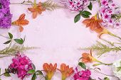 Colorful Flowers Of Pink, Red Phlox And Lily On A Pink Table With Place For Text, Top View, Flat Pla poster